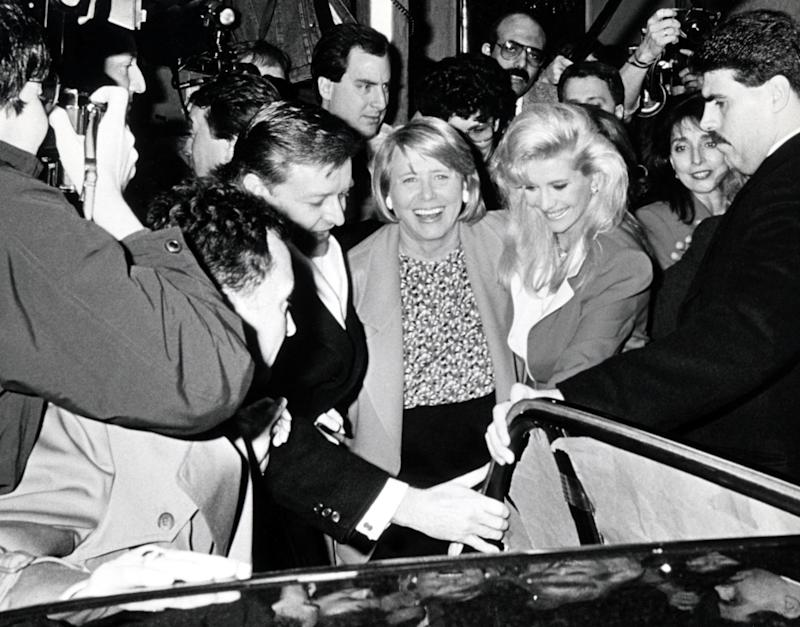 Smith took sides -- Ivana's -- in the Trump's 1990 divorce. Here, they were mobbed by press on the way to a birthday lunch for Ivana just after the divorce was announced. (Photo: Getty Images)