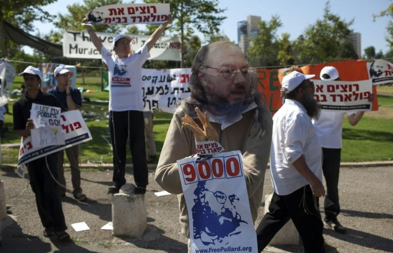 In this file photo from July 2011, Israeli youths demonstrate for Pollard's release in front of the American consulate in Jerusalem
