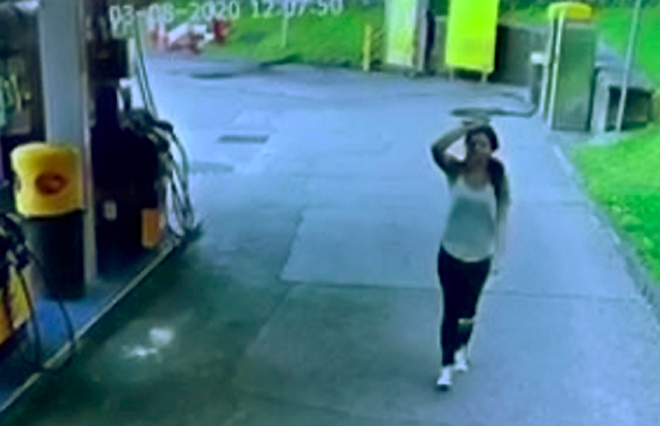 The woman was seen looking on helplessly as her car was stolen (SWNS)