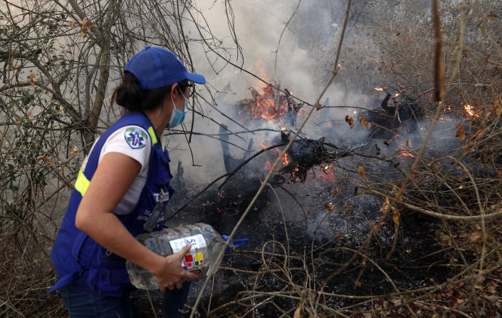 A volunteer works to put out a fire in Aguas Calientes on the outskirts of Robore, Bolivia, Aug. 24, 2019. (Photo: Juan Karita/AP)