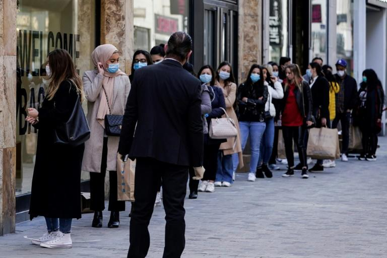 In Brussels, eager shoppers lined up outside stores