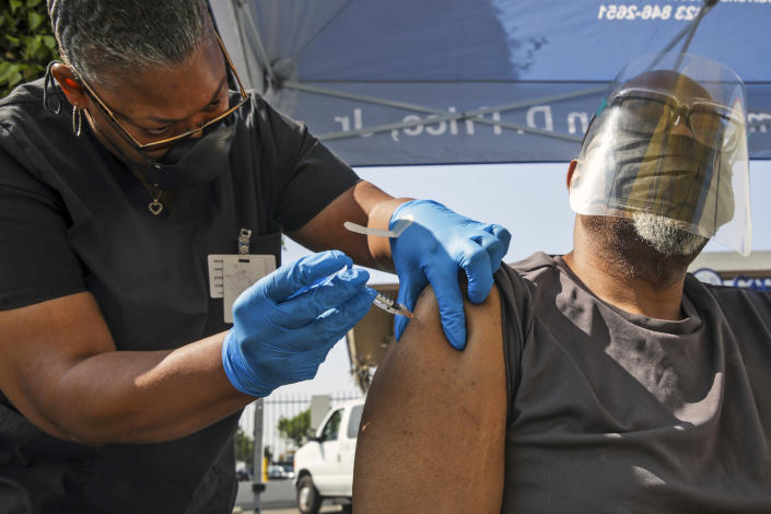 A health worker administers a Pfizer Covid-19 vaccination at a mobile vaccination clinic in Los Angeles on July 16, 2021. (Irfan Khan / Los Angeles Times via Getty Images)