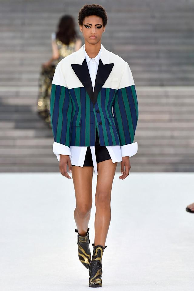 <p>A model in an oversize jacket walks the runway during the Louis Vuitton Resort 2018 show at the Miho Museum in Koka, Japan. (Photo: Getty Images) </p>