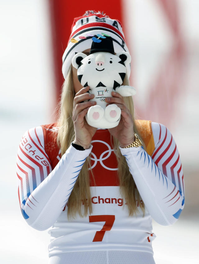 <p>Bronze medal winner Lindsey Vonn, of the United States, playfully places a stuffed Olympic mascot over her face as she celebrates during the flower ceremony for the women's downhill at the 2018 Winter Olympics in Jeongseon, South Korea, Wednesday, Feb. 21, 2018.(AP Photo/Christophe Ena) </p>