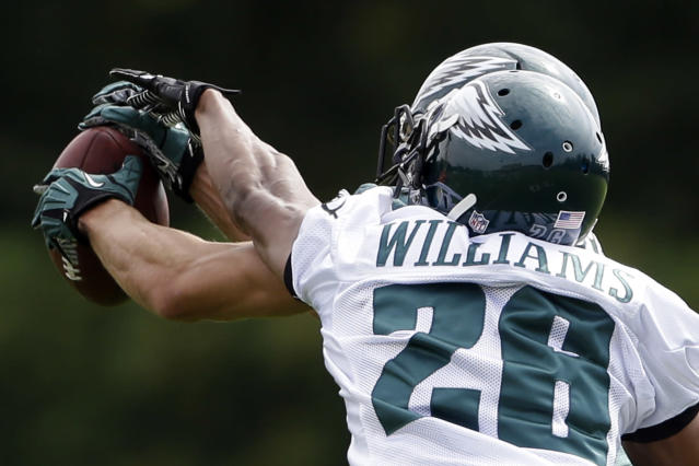 Philadelphia Eagles wide receiver Riley Cooper, rear, and cornerback Cary Williams (26) go for a pass during practice at the NFL football team's training facility, Thursday, Sept. 5, 2013, in Philadelphia. (AP Photo/Matt Rourke)
