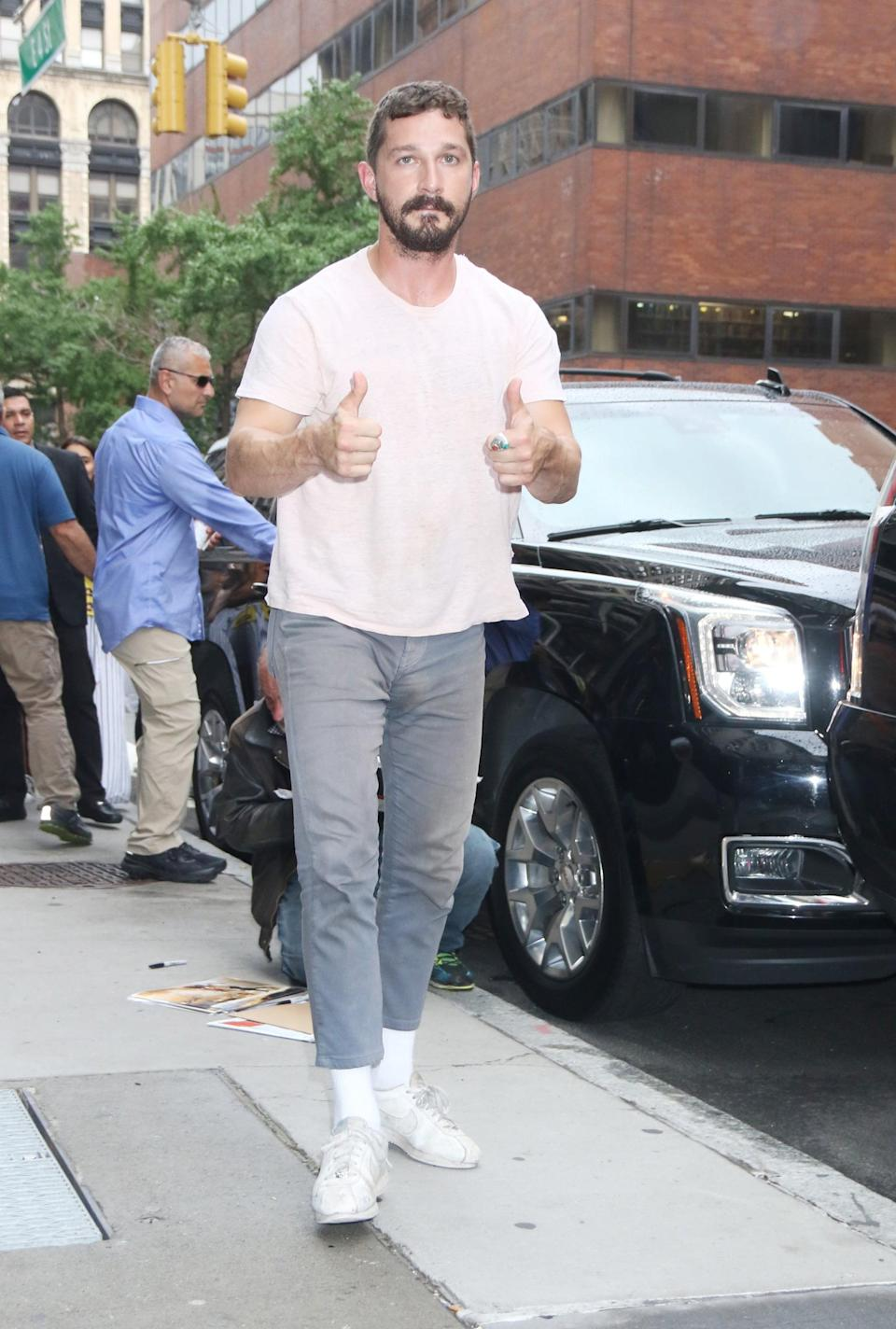 <p>A simple t-shirt with gray jeans can go a long way with a couple of thumbs up signs.</p>