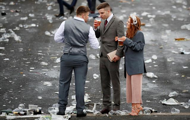 Horse Racing - Grand National Festival - Aintree Racecourse, Liverpool, Britain - April 13, 2018 General view of racegoers surrounded by litter during Ladies Day at the Grand National Festival Action Images via Reuters/Jason Cairnduff