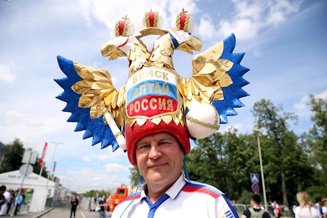 <p>Russian to be involved: A fan of the host nation sports some elaborate headgear in Moscow before the first Group A fixture. (Getty) </p>