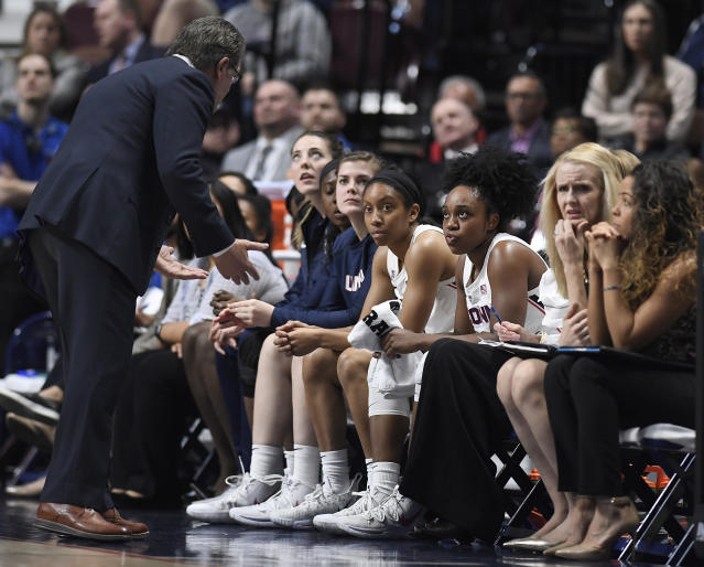 Connecticut head coach Geno Auriemma, left, talks with Connecticut's Christyn Williams, third from right, during the first half of an NCAA college basketball game in the American Athletic Conference tournament quarterfinals, Saturday, March 9, 2019, at Mohegan Sun Arena in Uncasville, Conn. (AP Photo/Jessica Hill)