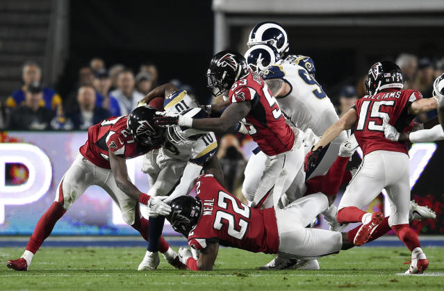 Atlanta Falcons players tackle Rams returner Pharoh Cooper in a playoff game last season. (AP)