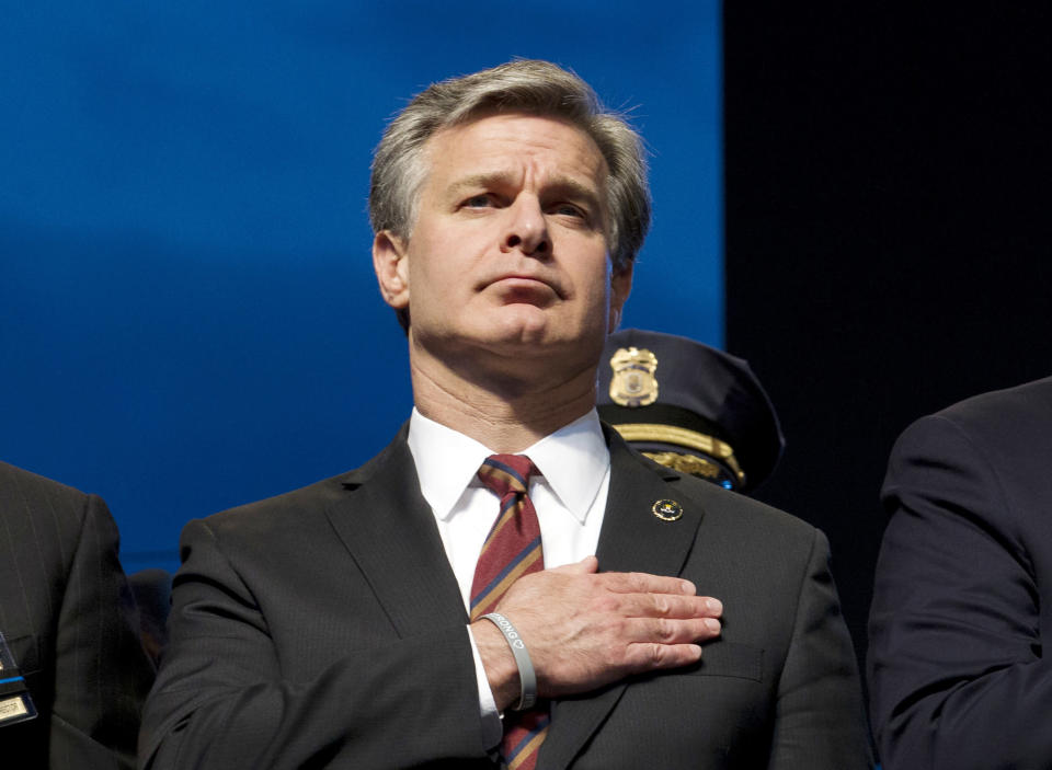 FILE - In this May 13, 2019, file photo, FBI Director Christopher Wray attends the National Law Enforcement Officers Memorial Fund Annual Candlelight Vigil to commemorate new names added to the monument, during a ceremony at the National Mall in Washington. Wray is set to testify before a Senate committee in what could be a preview of the questioning special counsel Robert Mueller may face on Wednesday, July 24, 2019. (AP Photo/Jose Luis Magana, File)