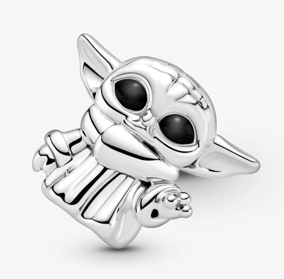 """For the kid who loves to make their own beaded bracelets, you might get them a charm that'll be fit right onto a silver bangle or chain. May the force be with them.<a href=""""https://fave.co/39x7lCy"""" target=""""_blank"""" rel=""""noopener noreferrer"""">Find it for $55 at Pandora</a>."""