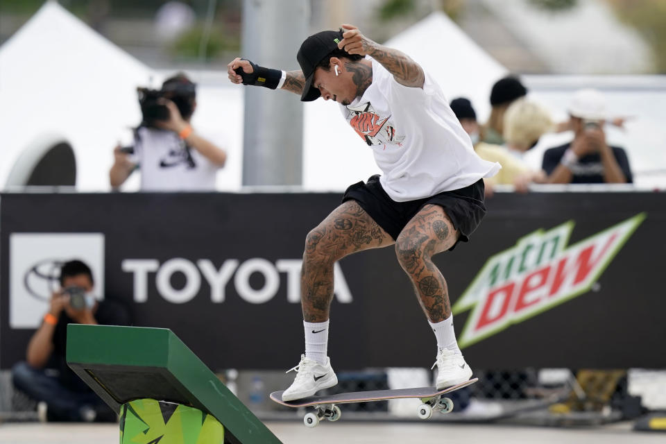 In this May 22, 2021, photo, Nyjah Huston, of the United States, practices during an Olympic qualifying skateboard event at Lauridsen Skatepark in Des Moines, Iowa. Where some skateboarders might be reluctant to move so boldly into the gargantuan realm of the Olympics, Huston is more than glad to latch on onto this monster. Tokyo might be the place where people outside the sport finally get a glimpse of one of the most interesting athletes around. (AP Photo/Charlie Neibergall)