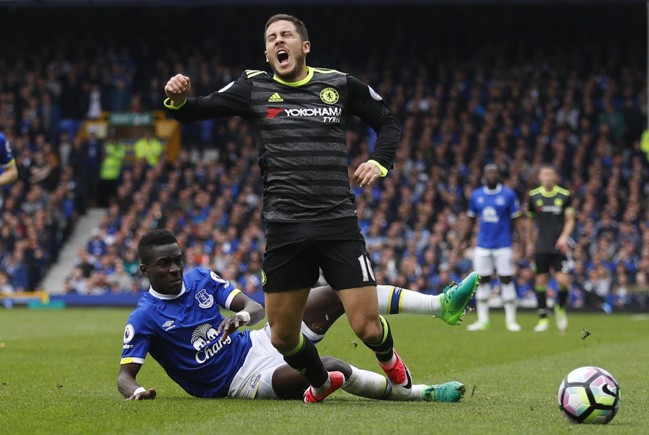 "Britain Football Soccer - Everton v Chelsea - Premier League - Goodison Park - 30/4/17 Chelsea's Eden Hazard is fouled by Everton's Idrissa Gueye  Reuters / Phil Noble Livepic EDITORIAL USE ONLY. No use with unauthorized audio, video, data, fixture lists, club/league logos or ""live"" services. Online in-match use limited to 45 images, no video emulation. No use in betting, games or single club/league/player publications.  Please contact your account representative for further details."