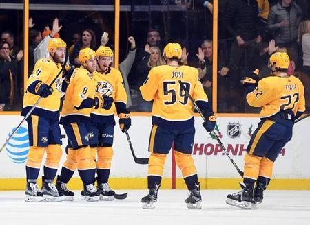 Nov 20, 2017; Nashville, TN, USA; Nashville Predators center Kyle Turris (8) celebrates with teammates after a goal during the second period against the Winnipeg Jets at Bridgestone Arena. Christopher Hanewinckel-USA TODAY Sports