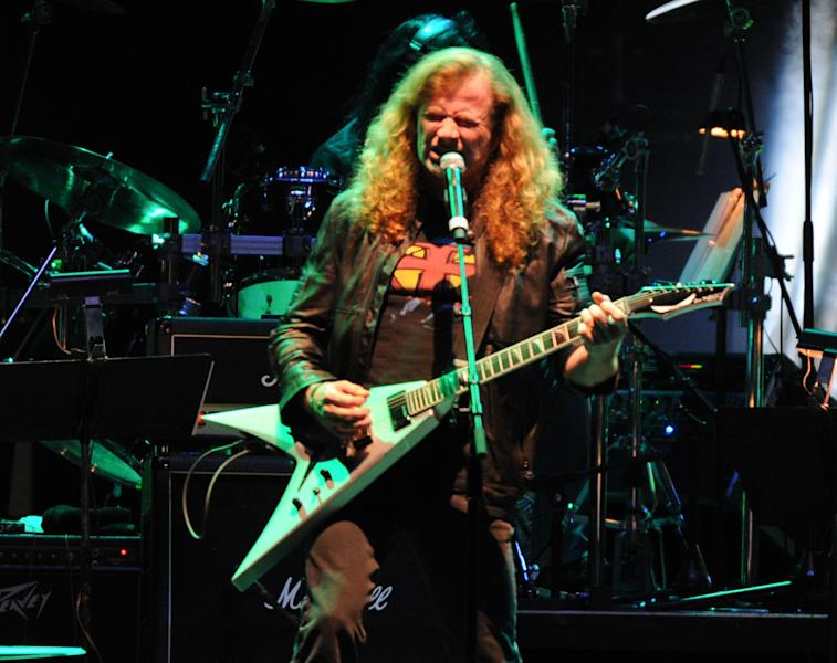 Megadeth and Jamey Johnson perform at the George Jones Tribute - Playin' Possum: The Final No Show, on Friday, Nov. 22, 2013 at the Bridgestone Arena in Nashville, Tenn. (Photo by Frank Micelotta/Invision/AP)