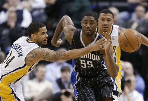 Indiana Pacers' D.J. Augustin (14) deflects the basketball from Orlando Magic's E'Twaun Moore (55) during the first half of an NBA basketball game Tuesday, March 19, 2013, in Indianapolis. (AP Photo/Darron Cummings)