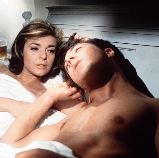 "FILE - In this publicity still, actors Anne Bancroft, left, and Dustin Hoffman appear in a scene from the 1967 film ""The Graduate."" (AP Photo, File)"