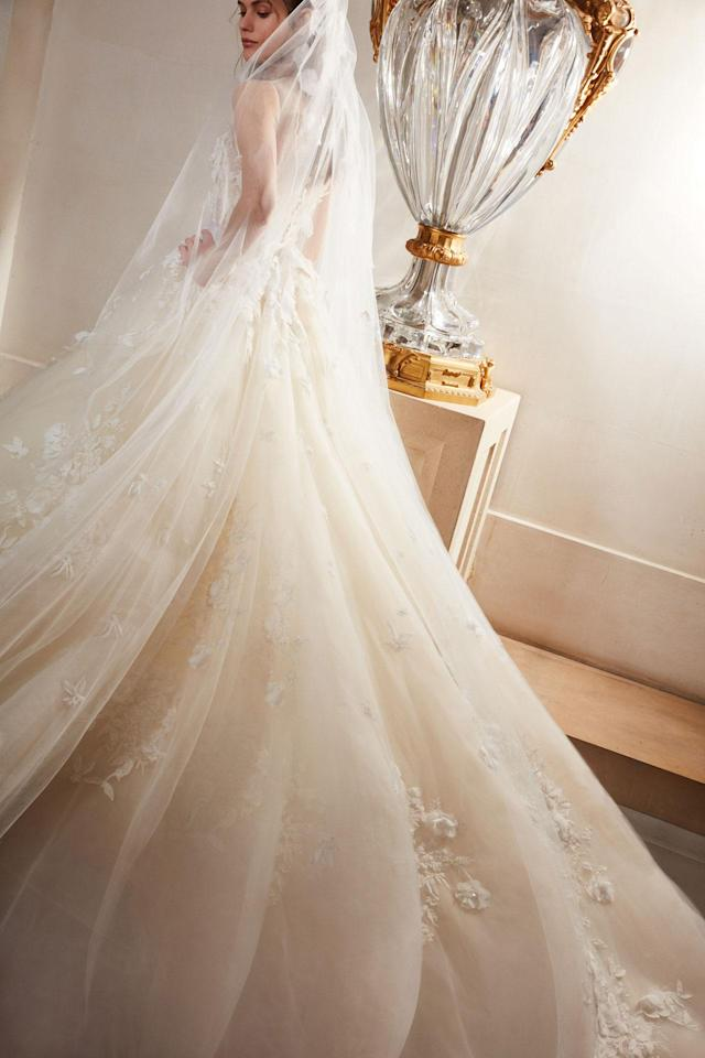 <p>Dress with long, voluminous train and long veil. (Photo: Courtesy of Elie Saab) </p>