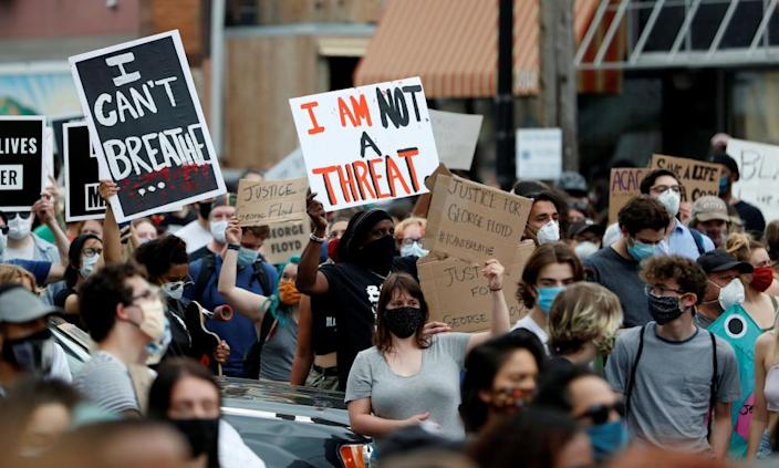 "<span class=""element-image__caption"">Protesters carried signs saying 'I can't breathe', quoting Floyd.</span> <span class=""element-image__credit"">Photograph: Eric Miller/Reuters</span>"