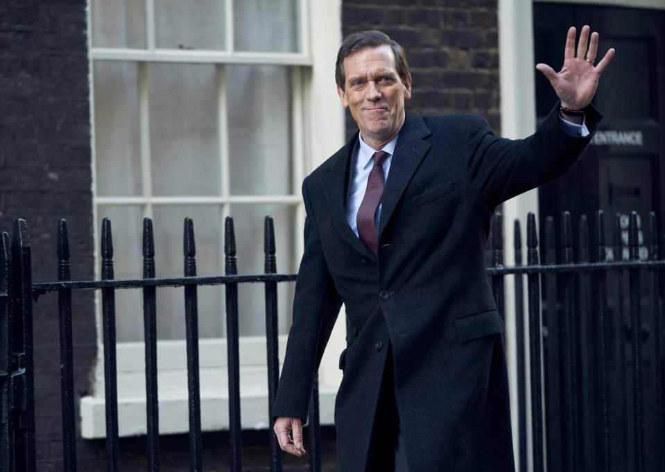 "This image released by PBS shows Hugh Laurie as a heedless British politician beset by scandal in the four-episode series ""Roadkill,"" premiering on MASTERPIECE, Sunday, Nov. 1, 2020 on PBS. (MASTERPIECE/PBS via AP)"