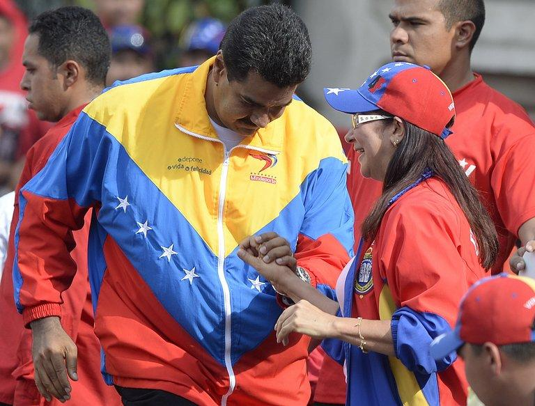 Venezuelan President Nicolas Maduro dances with First Lady Cicilia Flores in Caracas on May 1, 2013