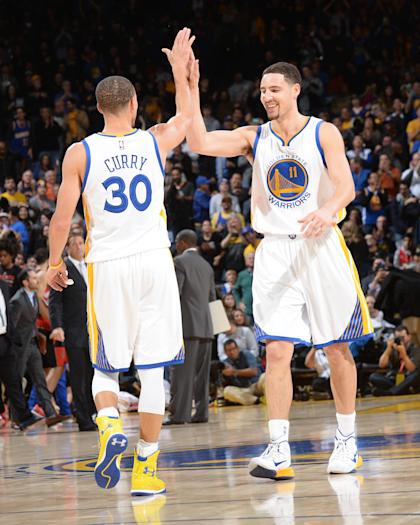 Stephen Curry (left) and Klay Thompson will start for the West in the All-Star Game. (NBAE/Getty Images)