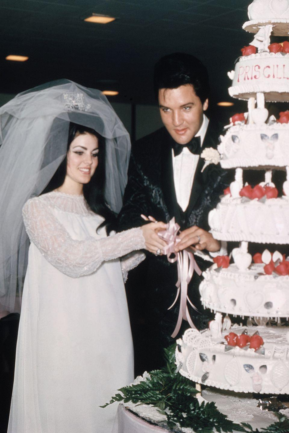 <p>Priscilla Presley designed her own white organza gown — fit for marrying The King. It had long lace sleeves and a three-quarter length veil that was secured by a rhinestone crown. Her now famous bouffant hairdo nearly rivaled Elvis Presley's pompadour.</p>