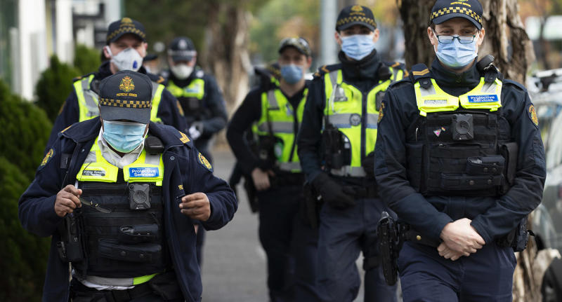 Police patrols are seen outside public housing towers in Flemington. Source: AAP