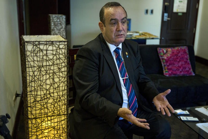 "Guatemala's President-elect Alejandro Giammattei gives an interview in Guatemala City, Tuesday, Aug. 13, 2019. Giammattei said Tuesday that Guatemala will not be able to hold up its side of an immigration agreement with the United States by serving as a ""safe third country"" for asylum seekers. (AP Photo/Oliver de Ros)"