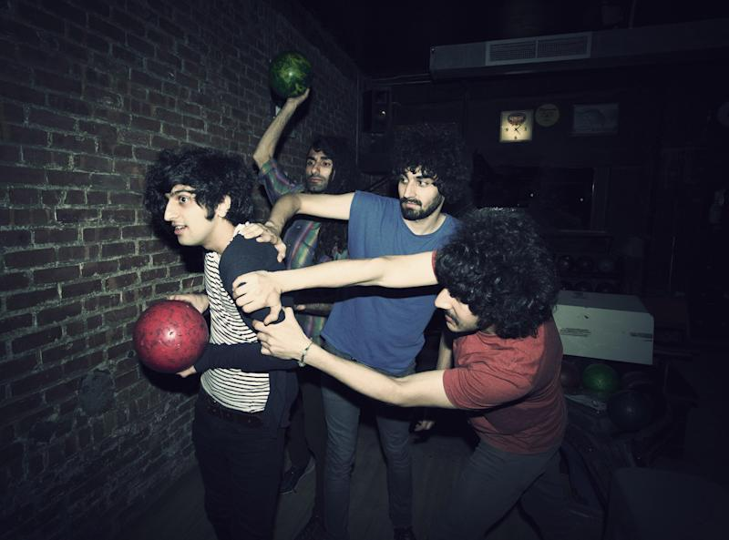 """This 2012 photo shows Yellow Dogs band members, from left, Koroush """"Koory"""" Mirzaei, Siavash Karampour, Arash Farazmand and Soroush Farazmand at The Gutter in the Brooklyn borough of New York. Police say a musician who shot and killed three other Iranian men inside a New York City apartment before committing suicide was upset because he had been kicked out of an indie rock band. Ali Akbar Mohammadi Rafie gunned down the men just after midnight on Monday, Nov. 11, 2013. Victims Soroush and Arash Farazmand were brothers who played in a band called the Yellow Dogs. The third victim, Ali Eskandarian was also a musician. After the shooting, investigators found a guitar case on a rooftop they believe the shooter may have used to carry the assault rifle used in the attack. (AP Photo/Danny Krug) NO SALES"""