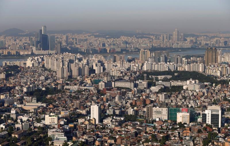 FILE PHOTO: The skyline of central Seoul is seen during sunrise in Seoul