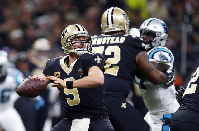 "<a class=""link rapid-noclick-resp"" href=""/nfl/players/5479/"" data-ylk=""slk:Drew Brees"">Drew Brees</a> completed a trifecta sweep of the Panthers on Sunday. (AP)"