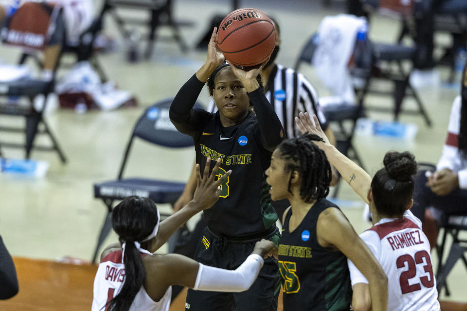 Wright State guard Jada Roberson (3) shoots over Arkansas guard Marquesha Davis (1) and guard Amber Ramirez (23) during the first half of a college basketball game in the first round of the women's NCAA tournament at the Frank Erwin Center in Austin, Texas, Monday, March 22, 2021. (AP Photo/Stephen Spillman)
