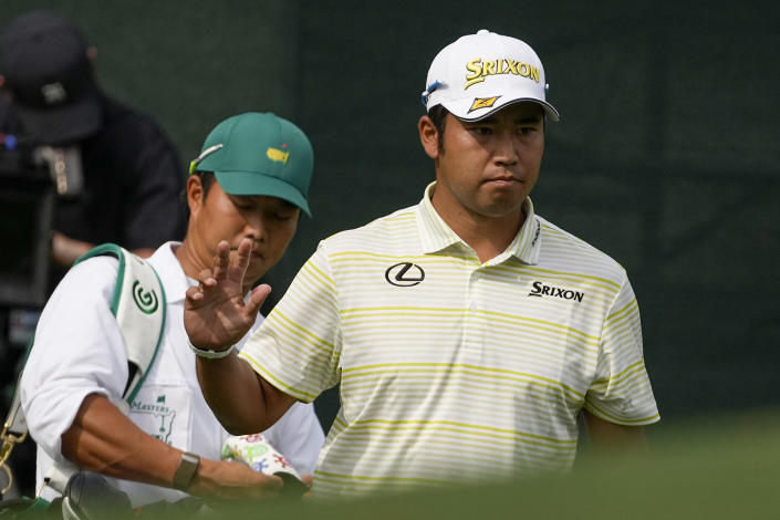 Hideki Matsuyama, of Japan, waves after a birdie on the eighth hole during the final round of the Masters golf tournament on Sunday, April 11, 2021, in Augusta, Ga. (AP Photo/Charlie Riedel)