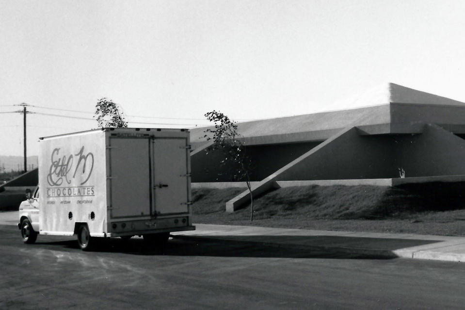 In this undated image provided by Ethel M Chocolates, a delivery truck is seen outside the Ethel M Chocolates building in Henderson, Nev. NASCAR driver Kyle Busch first went to the Ethel M candy factory with his grandmother. It wasn't a tourist stop to the young Busch, it was a candy store and his grandmother let him roam the cactus garden and rewarded him with the craft chocolates. It comes full circle Sunday at home track Las Vegas Motor Speedway. Ethel M is part of the Mars Corp., the longtime sponsor of Busch's team. Busch will feature the brand on his car in Sunday's race. (Ethel M Chocolates via AP)
