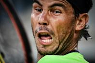 Face of a champion: Rafael Nadal reacts as he returns the ball to Richard Gasquet