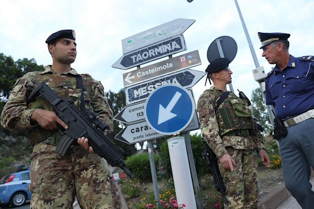 <p>Italian soldiers and police stand at a checkpoint at a road leading up to the historic town of Taormina, which will host the upcoming G7 summit, on the island of Sicily on May 23, 2017 in Taormina, Italy. (Photo: Sean Gallup/Getty Images) </p>