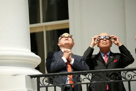 U.S. Attorney General Jeff Sessions (L) and Commerce Secretary Wilbur Ross watch the solar eclipse from the Truman Balcony at the White House in Washington, U.S., August 21, 1017 REUTERS/Kevin Lamarque