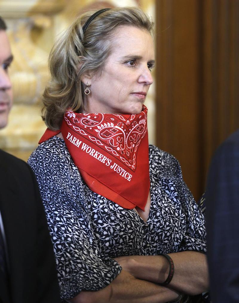 FILE - In this May 13, 2013 file photo, Kerry Kennedy listens to a speaker at a farm workers fair labor practices news conference in Albany, N.Y.  A town judge in New York is deciding whether the drugged-driving case against Kennedy should go to trial. The North Castle judge is expected to rule Tuesday May 21, 2013, on Kennedy's motion to dismiss the charge. (AP Photo/Mike Groll, File)