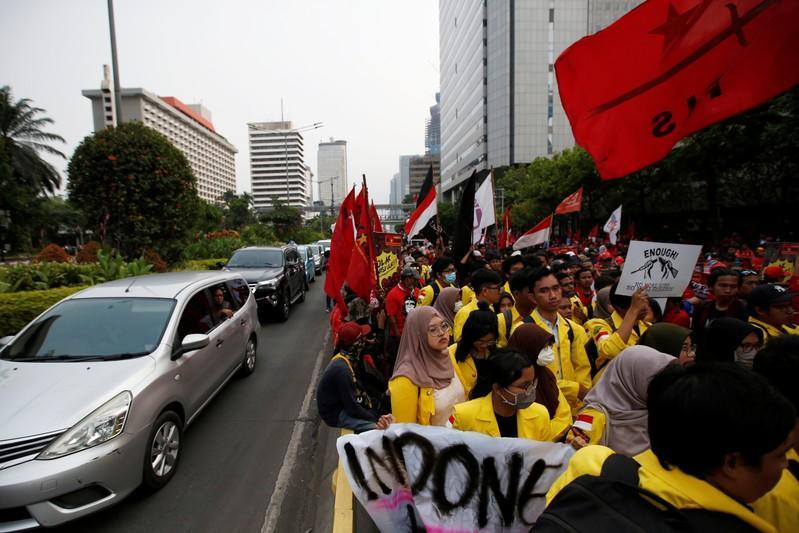 University students take part in a protest with Indonesian labour organisations over human rights, corruption and social and environmental issues in Jakarta, Indonesia