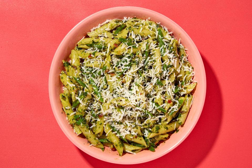 "About 30 seconds before you drain the pasta, throw the green beans into the boiling water—they'll cook in a hurry, and you'll save yourself time and another dish to wash. <a href=""https://www.epicurious.com/recipes/food/views/penne-with-almond-pesto-and-green-beans-56389804?mbid=synd_yahoo_rss"" rel=""nofollow noopener"" target=""_blank"" data-ylk=""slk:See recipe."" class=""link rapid-noclick-resp"">See recipe.</a>"