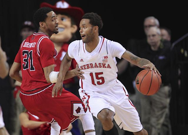 Nebraska's Ray Gallegos (15) tries to get around Arkansas State's Melvin Johnson III (31) in the first half of an NCAA college basketball game in Lincoln, Neb., Saturday, Dec. 14, 2013. (AP Photo/Nati Harnik)