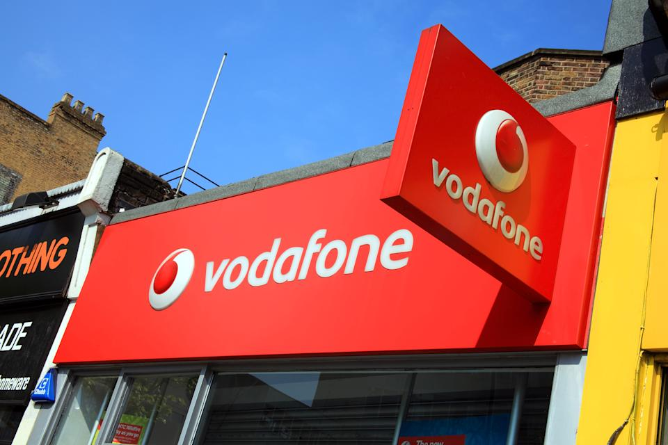 London, United Kingdom, April 17, 2011: Vodaphone logo advertising sign on one of its branch retail outlets in Notting Hill.