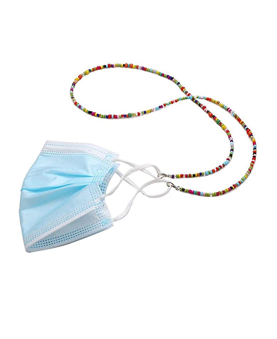 """Rainbow beading is never a bad idea, especially if it's used to jazz up your <a href=""""https://www.glamour.com/gallery/best-disposable-face-masks?mbid=synd_yahoo_rss"""" rel=""""nofollow noopener"""" target=""""_blank"""" data-ylk=""""slk:disposable face mask"""" class=""""link rapid-noclick-resp"""">disposable face mask</a>. $11, Amazon. <a href=""""https://www.amazon.com/Beaded-Lanyard-Necklace-Eyeglasses-Holders/dp/B08FT7RBJQ/"""" rel=""""nofollow noopener"""" target=""""_blank"""" data-ylk=""""slk:Get it now!"""" class=""""link rapid-noclick-resp"""">Get it now!</a>"""
