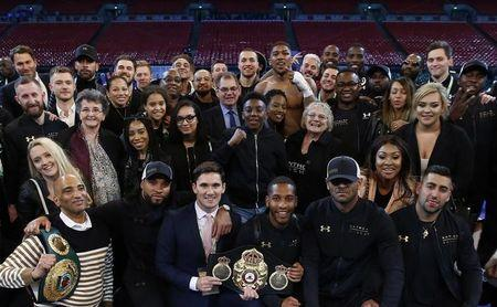 Britain Boxing - Anthony Joshua v Wladimir Klitschko IBF, IBO & WBA Super World Heavyweight Title's - Wembley Stadium, London, England - 29/4/17 Anthony Joshua poses for a photograph with friends and family after the fight Action Images via Reuters / Andrew Couldridge Livepic