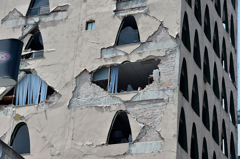 Exterior walls on a building crumbled during the earthquake.