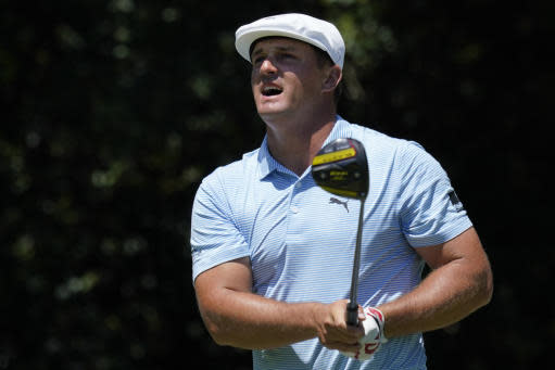 Bryson DeChambeau reacts to his tee shot on the 12th hole during the final round of the Charles Schwab Challenge golf tournament at the Colonial Country Club in Fort Worth, Texas, Sunday, June 14, 2020. (AP Photo/David J. Phillip)