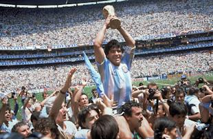 Diego Maradona holds up the World Cup trophy after Argentina beat West Germany 3-2 in 1986. (AP)