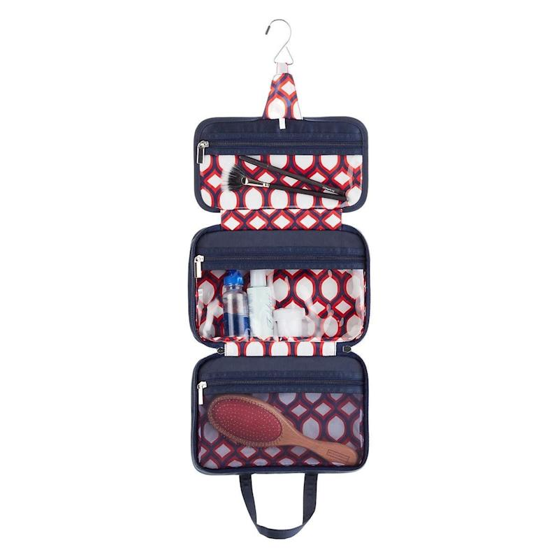 "Get it <a href=""https://www.containerstore.com/s/travel/makeup-toiletries/more-rockin-moroccan-hanging-weekender/12d?productId=11002954"" target=""_blank"">here</a>."